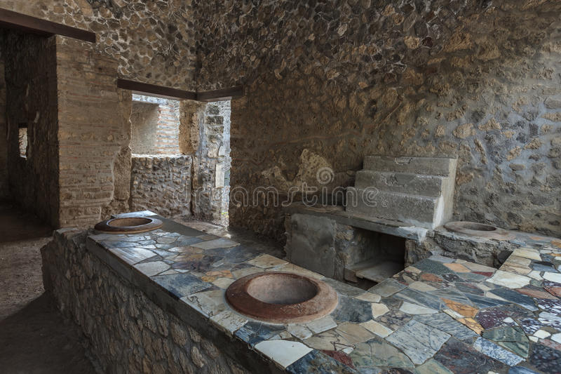 Pompeii, Italy. Ancient Pompeii - Thermopolium of Asellina with old food serving counter stock image