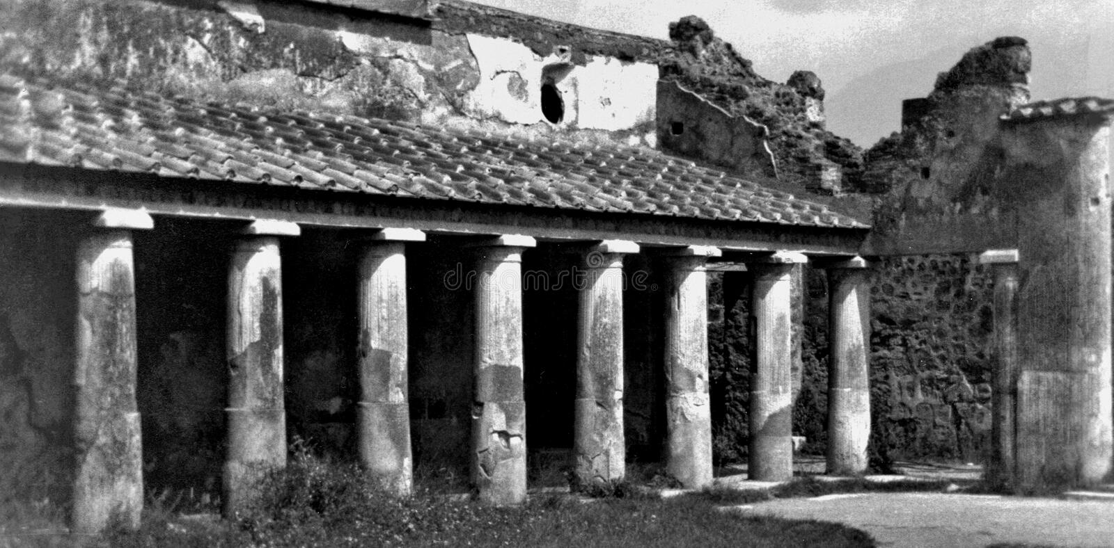 Pompeii Italy, circa 1984, ruins of a public building. City of Pompeii Italy, circa 1984, ruins of a public building that had been significantly recovered by stock photos