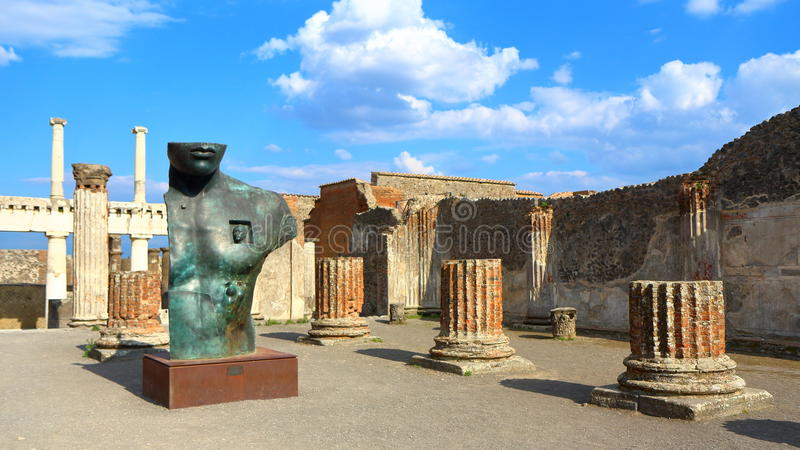 Pompeii, Italy: Mitoraj statue. Pompeii, Italy - March 28, 2017: Sculptures of the Polish sculptor Igor Mitoraj on display at Pompeii archaeological site, the stock image