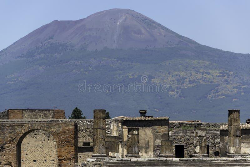Pompeii and Mt. Vesuvius. Ruins of Pompeii with Mt. Vesuvius in the background stock image