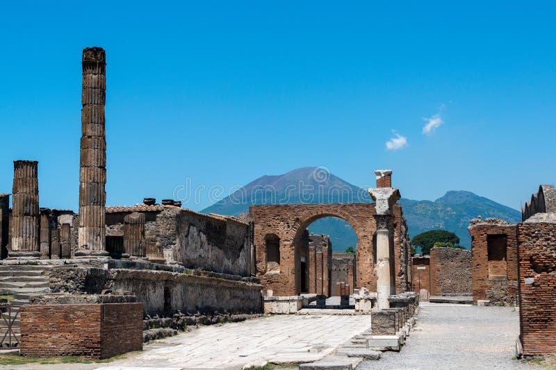 Pompeii and Mt. Vesuvius. Ruins of Pompeii with Mt. Vesuvius in the background royalty free stock images