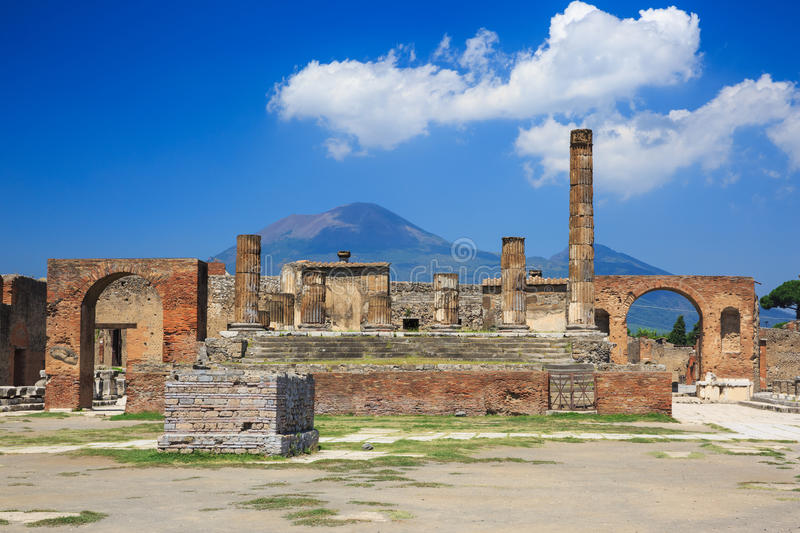 Pompeii, Naples Italy. Temple of Jupiter and Mt. Vesuvius in the background at the ancient city of Pompeii, Naples Italy royalty free stock image