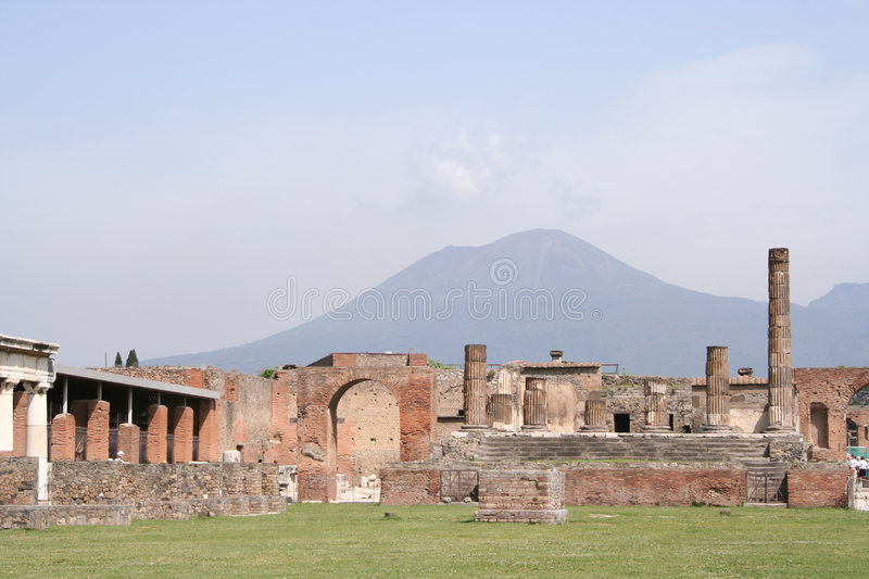 Pompeii overlooked by Vesuvius. Part of the ruins at Pompeii, overlooked by Mt Vesuvius. Italy royalty free stock image