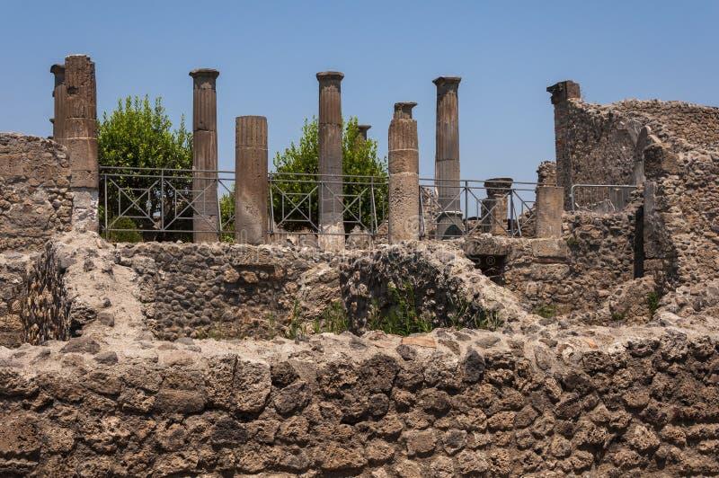 Pompeii. Roman Pompeii ruins, Columns in Regio VIII royalty free stock photos