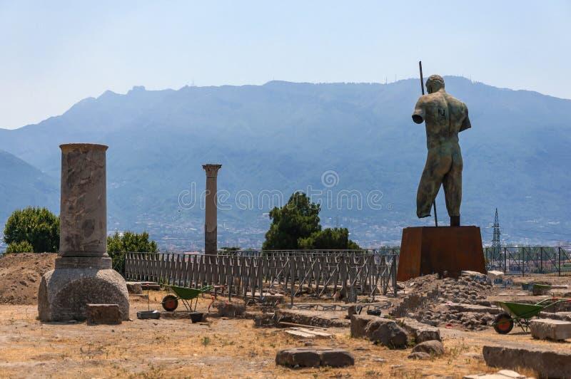 Pompeii. Roman Pompeii ruins, Dedalo Bronze Statue by Igor Mitoraj in Regio VIII stock photos