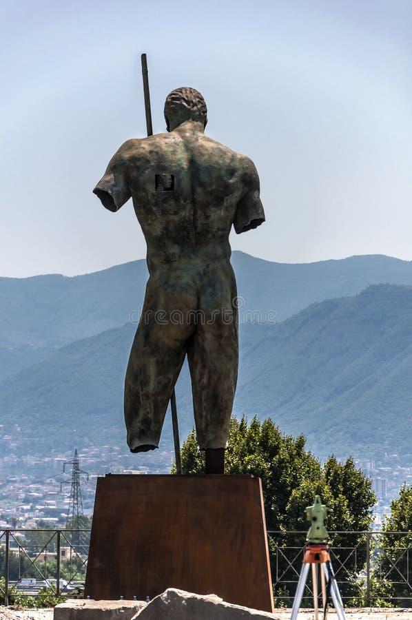 Pompeii. Roman Pompeii ruins, Dedalo Bronze Statue by Igor Mitoraj in Regio VIII stock image