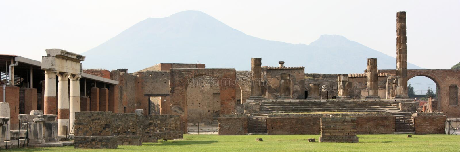 Pompeii Ruins Panoramic. With Mount Vesuvius in the background, a panoramic view of the ruins at Pompeii stock photo