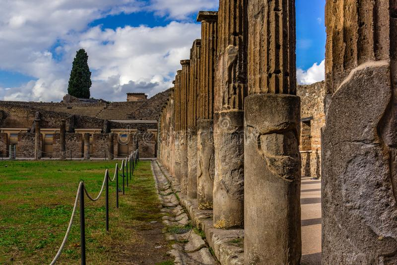 Pompeii ruins: stone columns at archeological site. Remains of the ancient Pompeii town destroyed by eruption of volcano Vesuvius, Italy, antique, archeology stock image