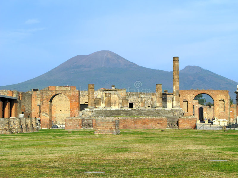 Pompeii Temple of Jupiter. The Temple of Jupiter at the city of Pompeii with Mount Vesuvius in the background. (Italy royalty free stock images
