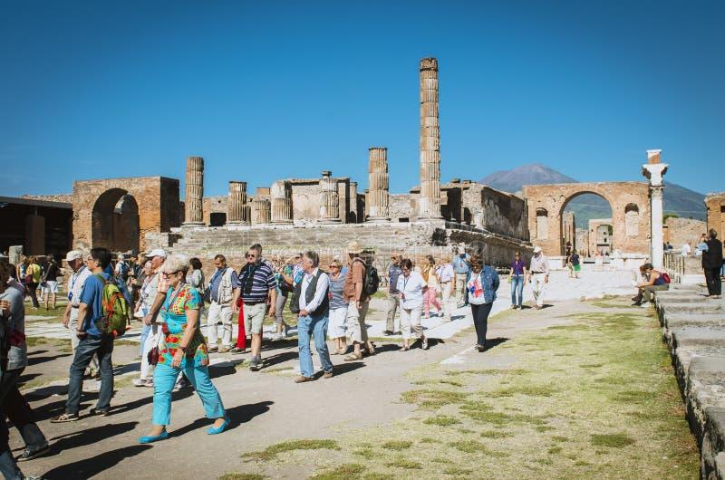 Pompeii, tourists orientali si fotografano in the ancient Roman forum. Pompeii, Italy 03 october 2013: Oriental tourists photographing in the ancient Roman forum royalty free stock images