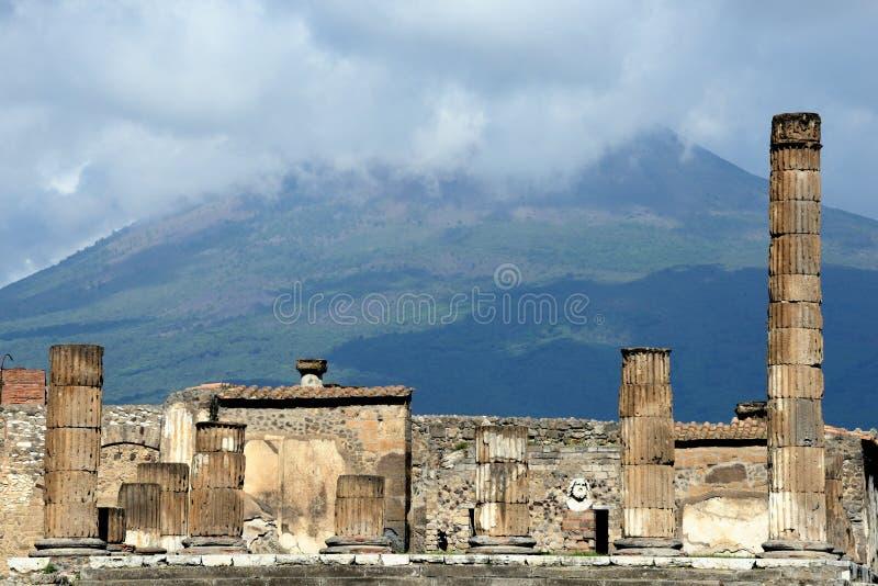 Pompeii and Vesuvius. The ruins of Pompeii with the volcano Vesuvius in the background stock photography