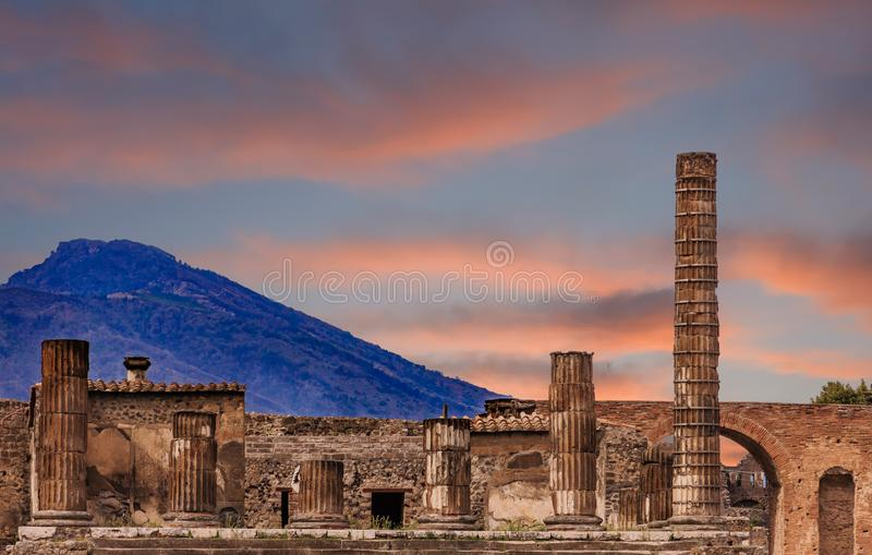 Pompeii and Vesuvius at Dusk. Details of the Ancient city of Pompeii destroyed by volcano of Vesuvius royalty free stock photo