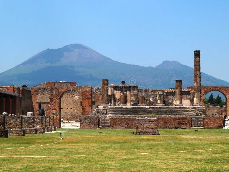 Pompeii. View of the Pompeii ruins and Vesuvius volcano in background royalty free stock photos