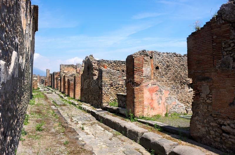 Streets of Pompeii-I- Italy. Pompeii was an ancient city in Campania on the Gulf of Naples, which like Herculaneum, Stabiae and Oplontis was buried during the royalty free stock photography