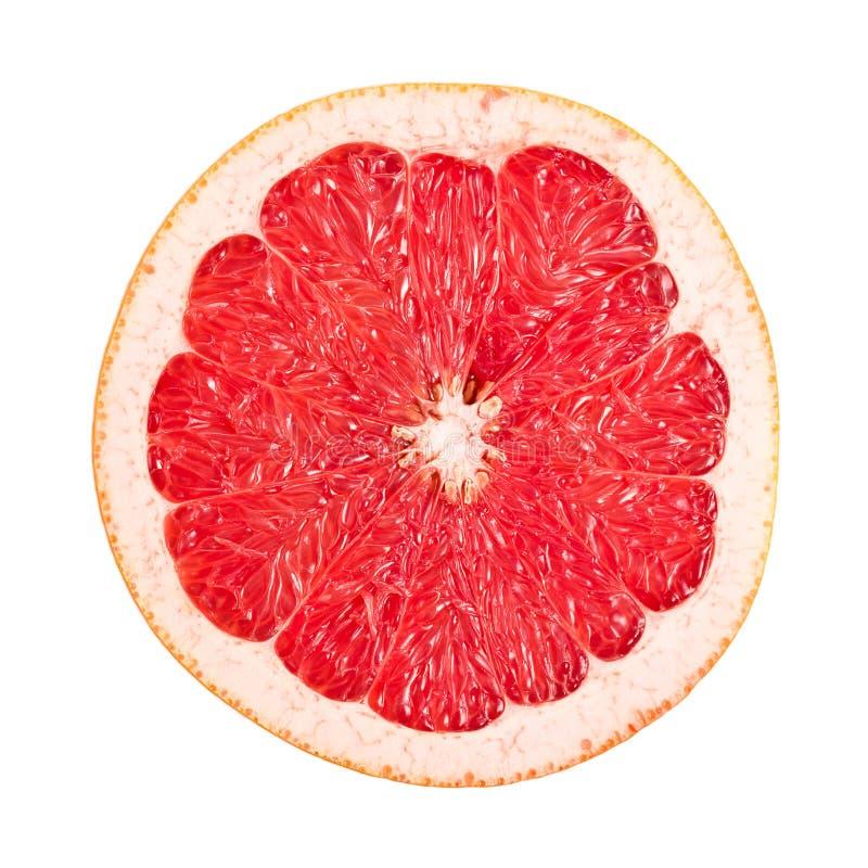 Pompelmo rosso affettato su bianco immagini stock