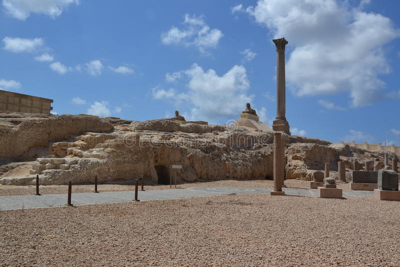 Pompey's Pillar in Alexandria, Egypt. Pompey's Pillar is a Roman triumphal column in Alexandria, Egypt, and the largest of its type constructed outside of the royalty free stock photo