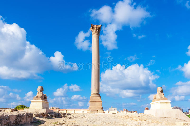 Pompey`s pillar and ancient sphinx royalty free stock photography