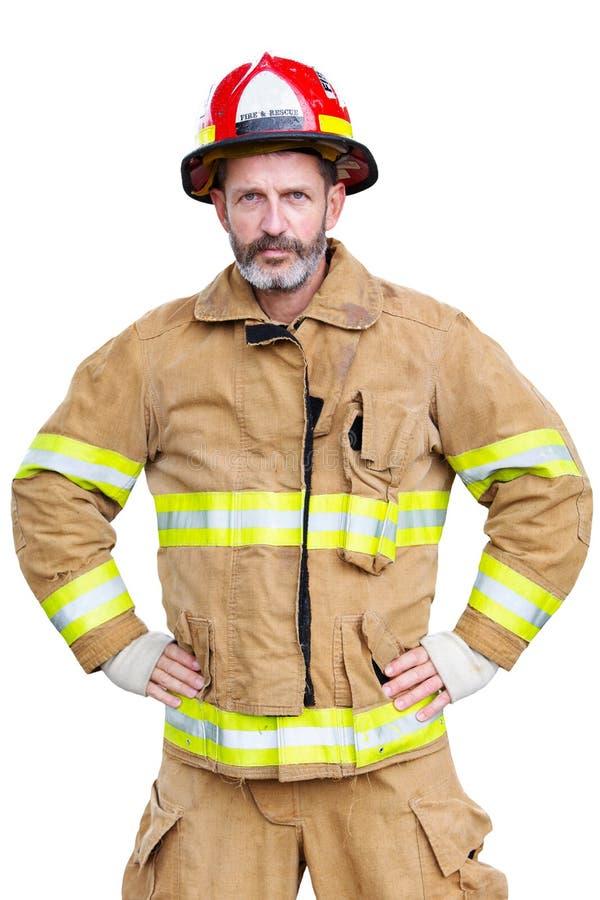 Pompier beau dans l'uniforme avec le fond blanc photo libre de droits