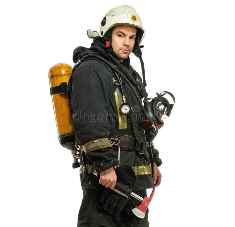 Pompiere con il pallone dell'ossigeno e dell'ascia fotografia stock libera da diritti