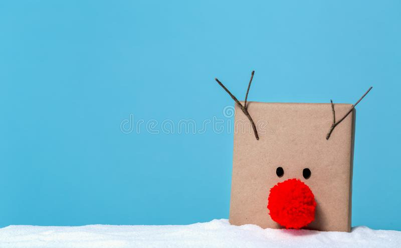 Pompom reindeer gift box stock image