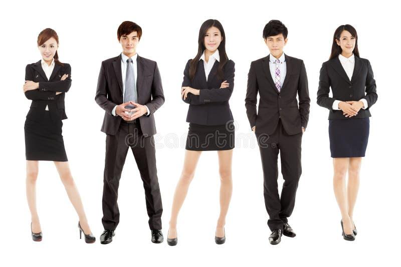 Pomyślna azjatykcia młoda biznes drużyna stoi wpólnie fotografia royalty free