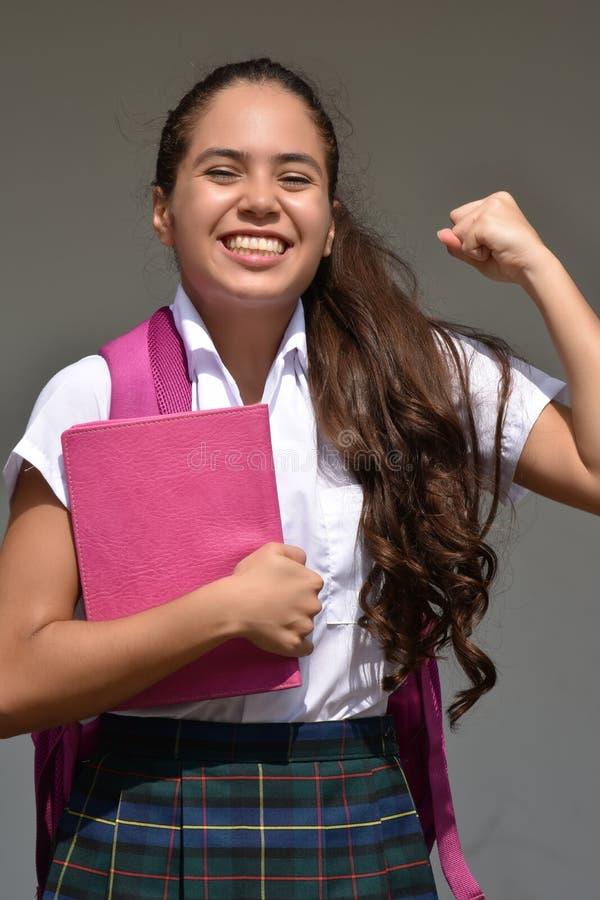 Pomyślna Katolicka Kolumbijska osoba Jest ubranym mundurek szkolnego obraz stock