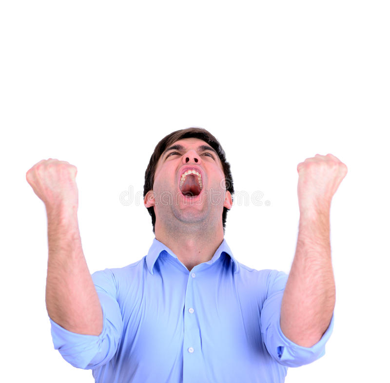 Pomyślna mężczyzna odświętność z rękami up i krzyczeć radości isol zdjęcia stock