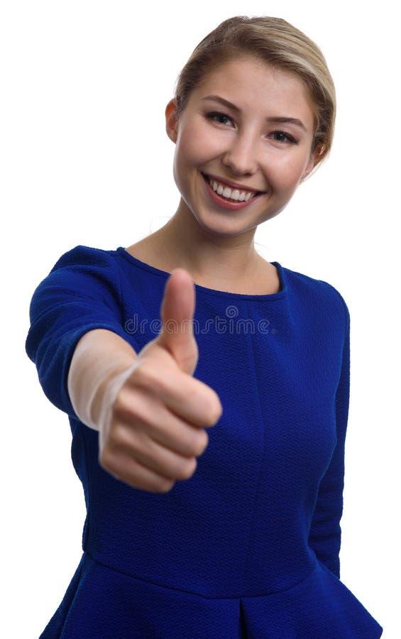 Pomyślna młoda kobieta gestykuluje aprobaty zdjęcie stock