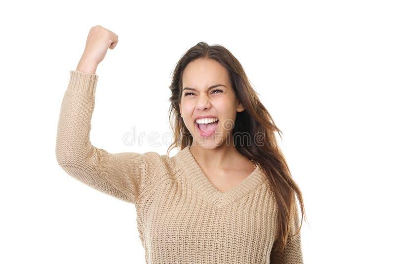 Pomyślna młoda kobieta ono uśmiecha się i świętuje z pięści pompą obrazy royalty free