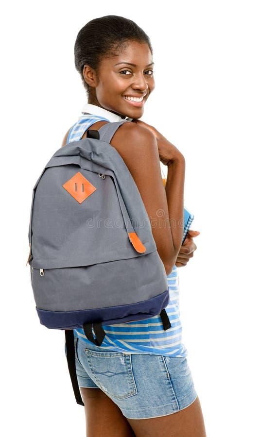 Pomyślnego amerykanina afrykańskiego pochodzenia studencka kobieta iść z powrotem szkoła ja fotografia stock