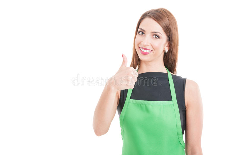 Pomyślny żeński pracownik pokazuje kciuk up fotografia stock