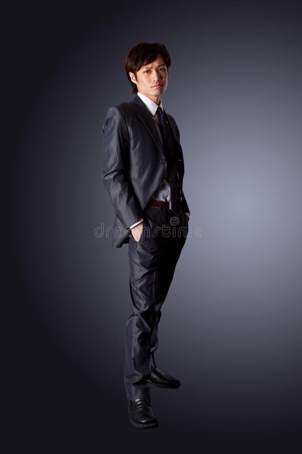 pomyślny azjatykci biznesowy mężczyzna zdjęcia stock