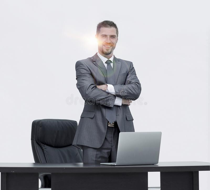 Pomyślny lider, stoi za biurkiem obraz royalty free