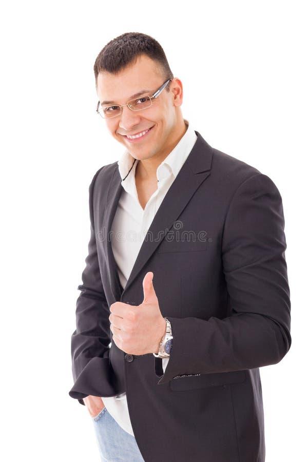 Pomyślny młody biznesmen pokazuje aprobaty zdjęcie stock