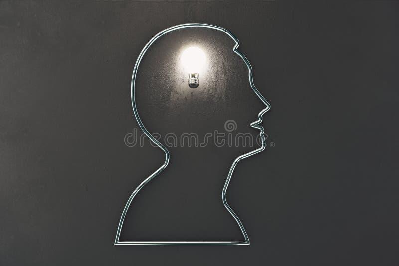 Pomysłu pojęcie z sylwetka mężczyzna profilową i rozjarzoną żarówką royalty ilustracja