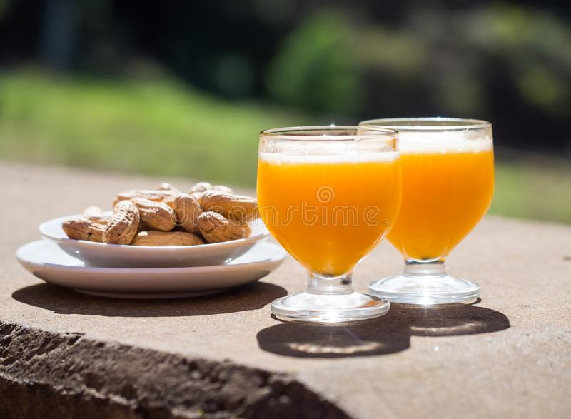 Poncha, a traditional alcoholic drink from the island of Madeira, made with aguardente de cana and fresh passion fruit. Served royalty free stock photo