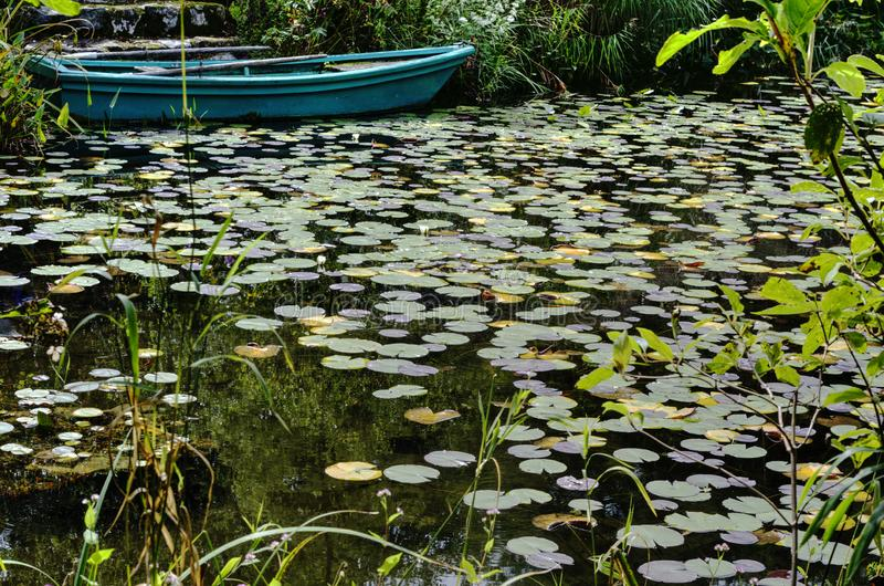 Pond with boat and water lilies. Inspired by French impressionist Monet in  Garden Museum Hiei on the top of Mt. Hiei, Kyoto, Japan stock photo