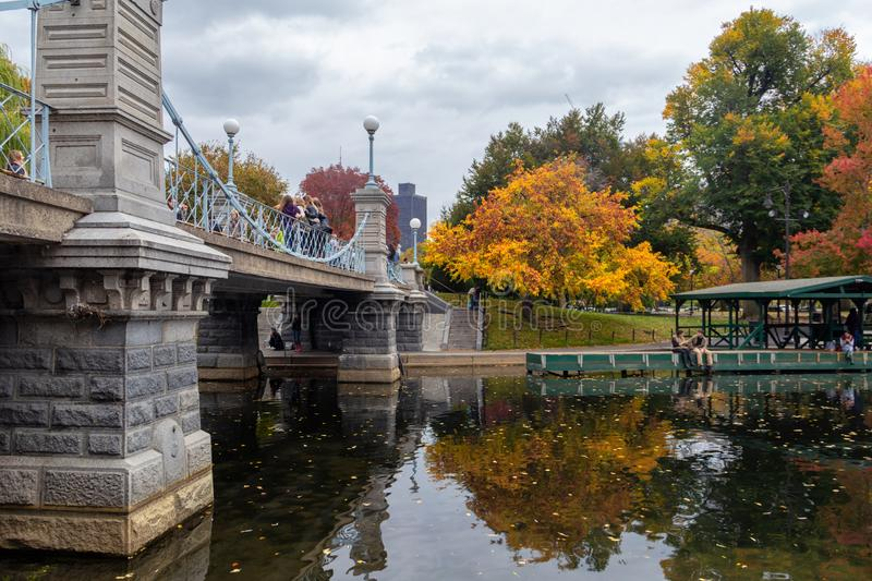 Pond in Boston Garden park on a cloudy day in fall season. BOSTON, USA - OCTOBER, 2015: Pond in Boston Garden park on a cloudy day in fall season stock images