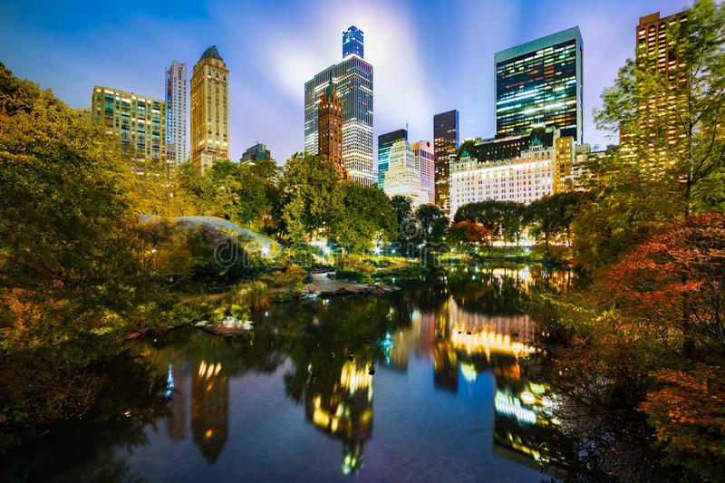 The Pond in Central Park, NYC. The Pond by night, as viewed from Gapstow Bridge in Central Park, New York City stock photography