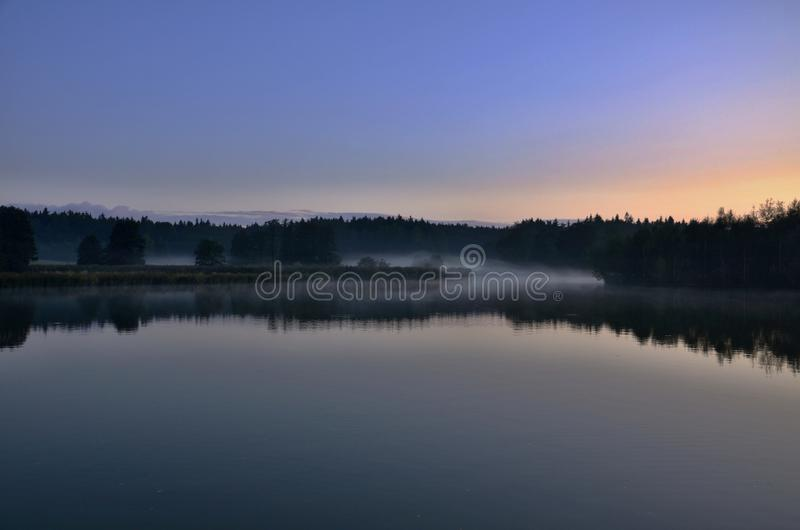Pond with fog stock photography