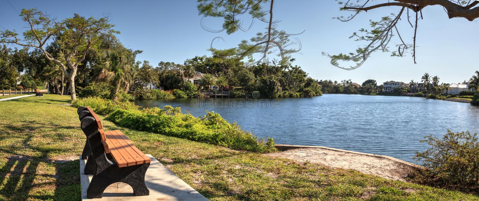 Pond and a park from a bench in Naples, Florida stock image