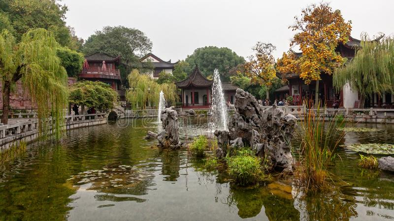 A pond at the Yellow Crane Tower Park in Wuhan, China. On a cloudy November day royalty free stock photo