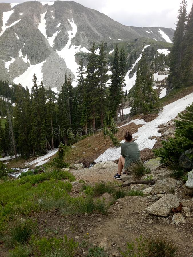 Pondering hiking snow Colorado royalty free stock image