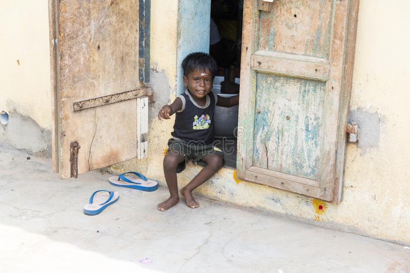 Portrait of unidentified Indian poor kid boy is smiling outddor in the street. PONDICHERY, PUDUCHERRY, TAMIL NADU, INDIA - SEPTEMBER CIRCA, 2017. Portrait of stock images