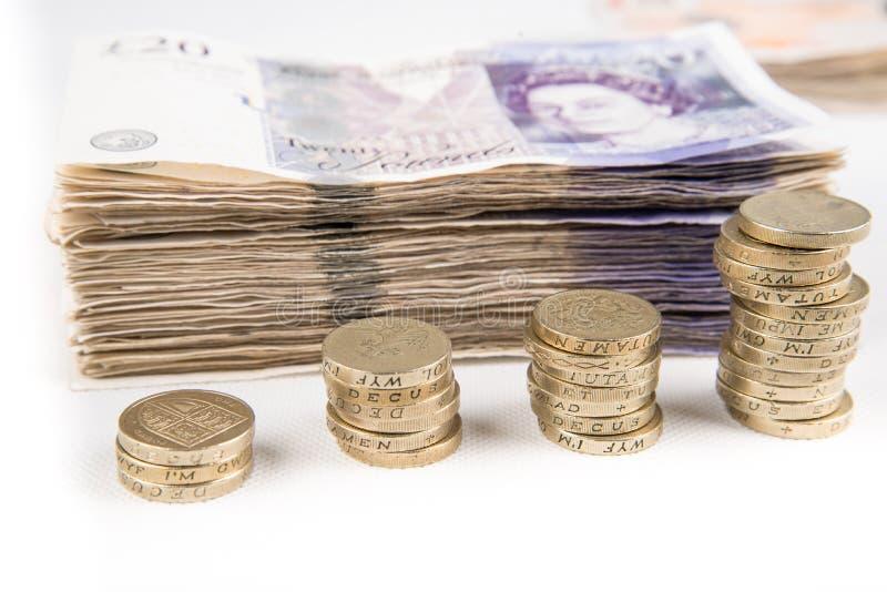 Pondnota's en muntstukken royalty-vrije stock afbeelding