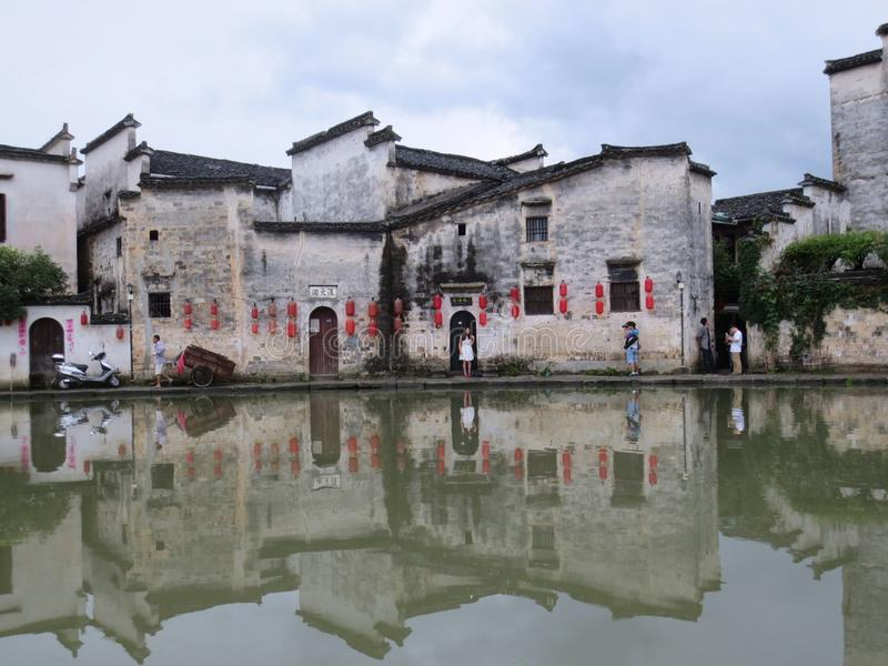 A pond and building facade in hongcun, anhui province royalty free stock photos