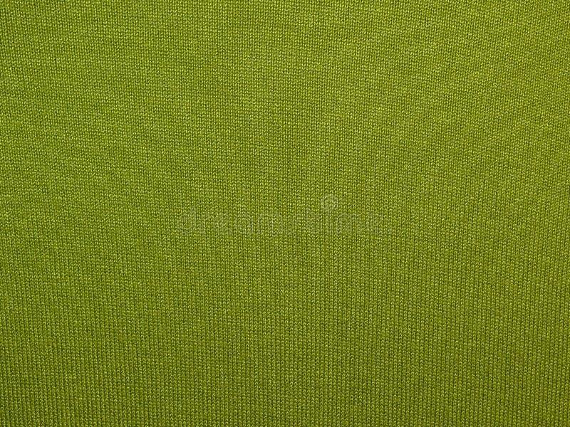 Ponga verde la tela hecha punto foto de archivo