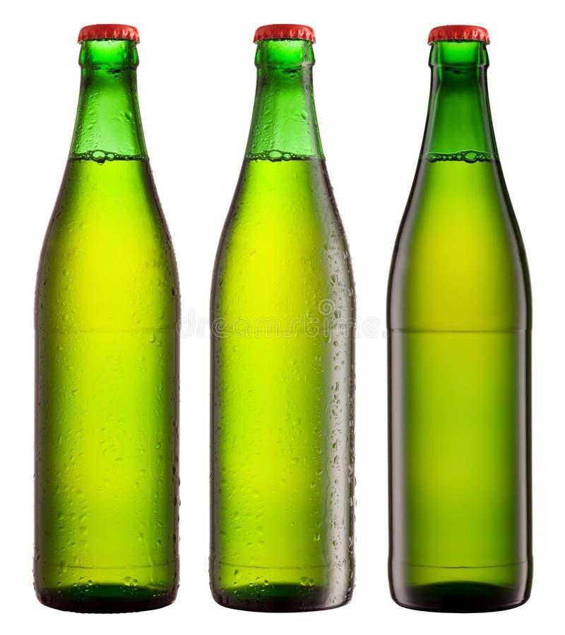 Ponga verde las botellas de la bebida foto de archivo