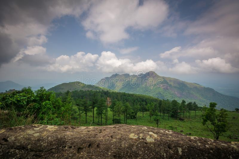 Clouds and trees in Ponmudi Hills stock image