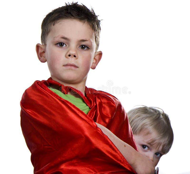 Ponowna przylądka supe chłopiec. zdjęcie royalty free